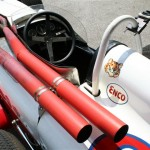 vintage Indy 500 race car; note closeness of exhaust pipes to driver!