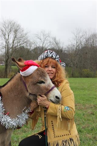 Katrina and one of our miniature donkeys getting ready for the parade.