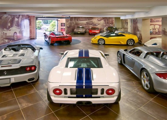 The toys in this garage and the finish of the garage tell the story of this man's Cave.